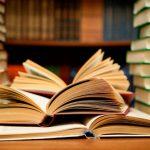 O izbiri čtiva za bralni klub: Odprte knjige med kupi knjig